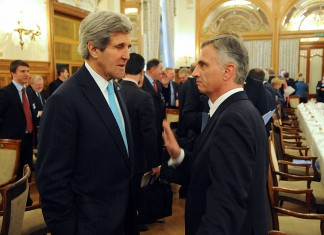 U.S. Secretary of State John Kerry chats with Swiss Federation President Didier Burkhalter before a delegates luncheon at the Geneva II conference in Montreux, Switzerland, on January 22, 2014. [State Department Photo/ Public Domain]