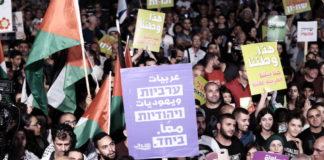 Arabische Israelis und andere Aktivisten protestieren am 11. August 2018 in Tel Aviv gegen das neue Nationalstaatsgesetz. Foto Tomer Neuberg/Flash90.