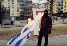 "Neonazis in Finnland verbrennen israelische Flagge. Foto Screenshot Video ""Kohti Vapautta!"""