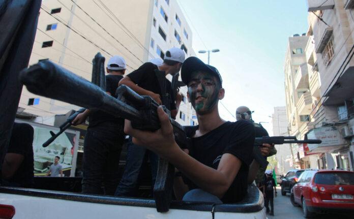 Junge Palästinenser nehmen an einer Abschlusszeremonie in einem von der Terrororganisation Hamas organisierten militärischen Sommerlager in Gaza-Stadt teil, 08. Juli 2021. Foto IMAGO / ZUMA Wire